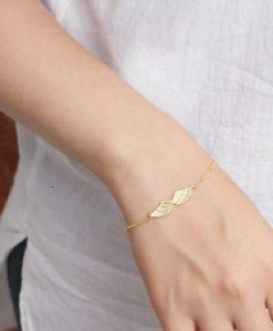 pulsera alas de angel dorado
